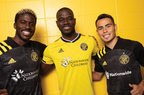 SCORE: Columbus Crew SC players, from left, Gyasi Zardes, Jonathan Mensah and Lucas Zelarayan, wear their new jerseys featuring Nationwide and Nationwide Children's Hospital logos. Photo courtesy of Columbus Crew SC. Photo by Alex Brown.