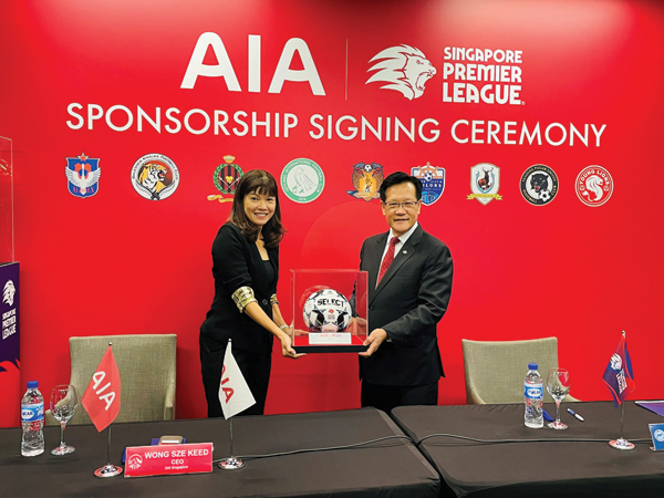 COMING TOGETHER: AIA Singapore CEO Wong Sze Keed (left) and Football Association of Singapore President Lim Kia Tong announce the insurer's renewed sponsorship of the Singapore Premier League. Photo courtesy of AIA Singapore